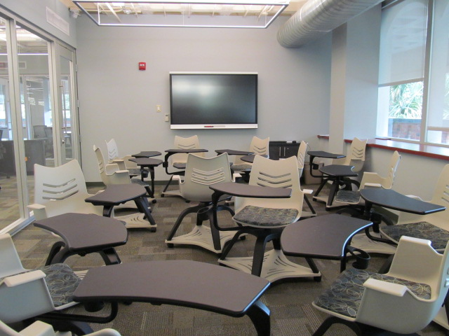 Smartboard Room with rolling chairs and a smart television