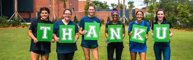 Students holding Thank You sign