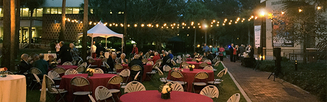 An outdoor night event in the Palm Court