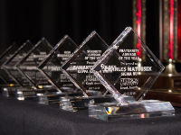Photographer, Ernie Castro captures a photo of the Greek Award trophies.