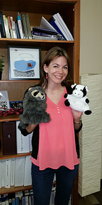 program coordinator with puppets