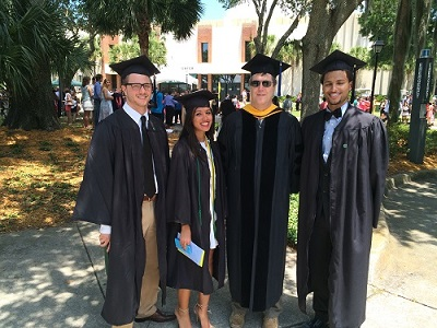 media/Kevin with grad students.JPG
