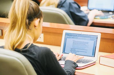 Female Law Student at Computer