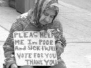 Homeless Woman Holding Sign Asking for Help