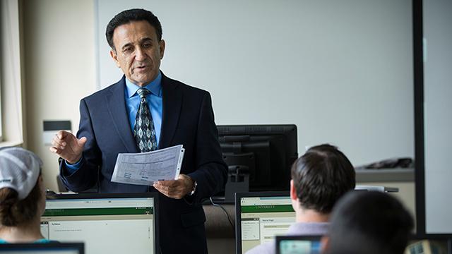 Professor Amiri teaching in computer lab
