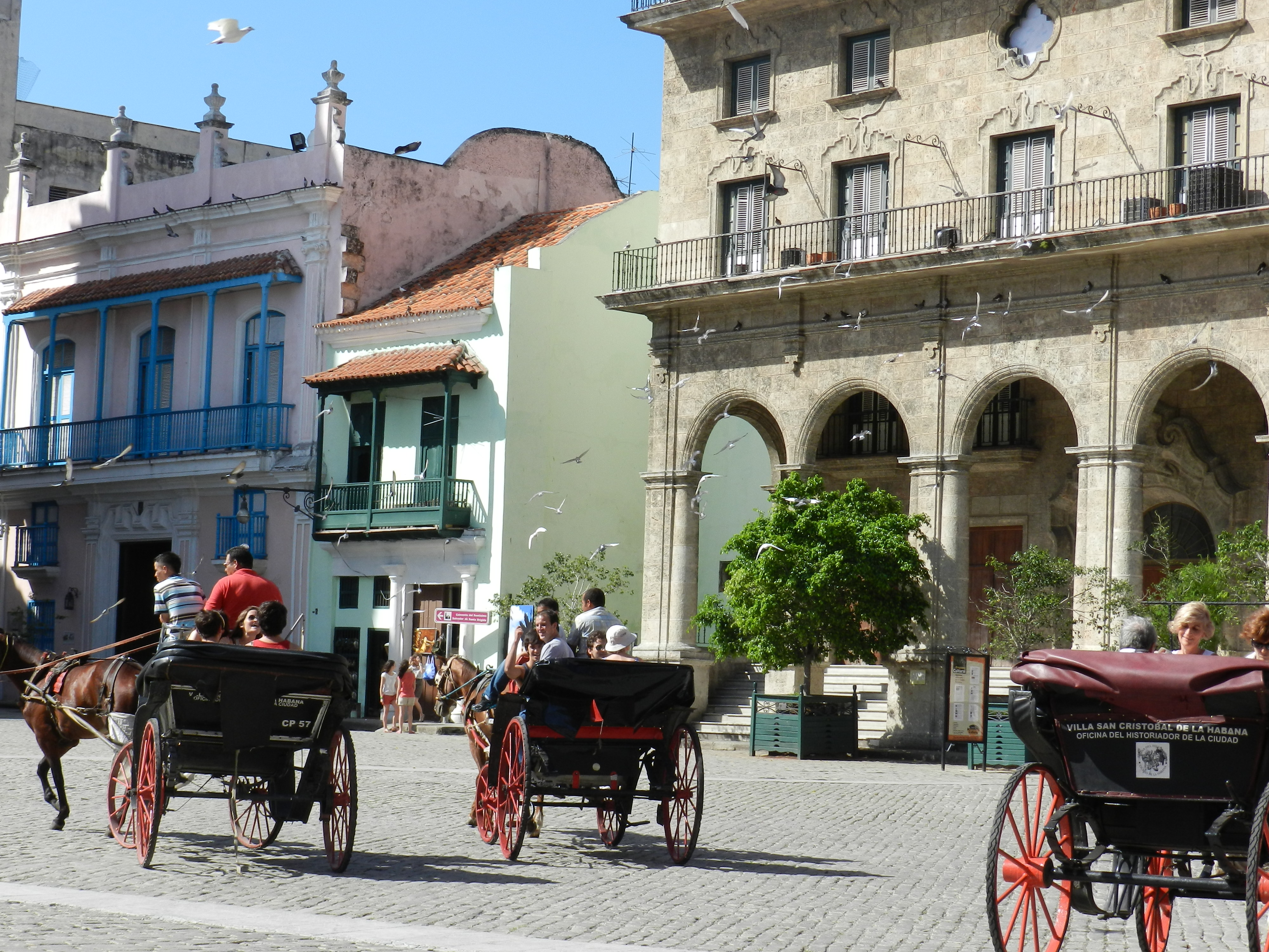 cuban city with horse and carriages