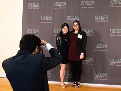 student taking photo of fellow awardees