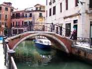 Venetian water canal with bridge