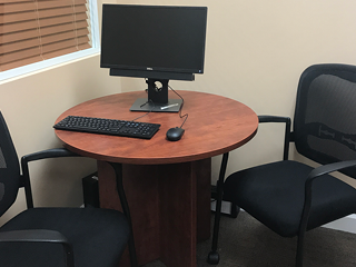 sales lab with two chairs and a computer