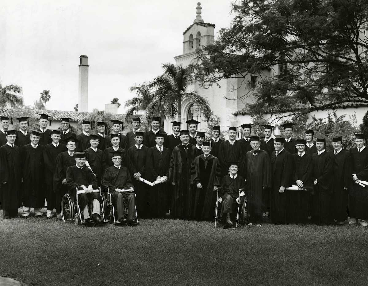 Class of 1959 at graduation with faculty members