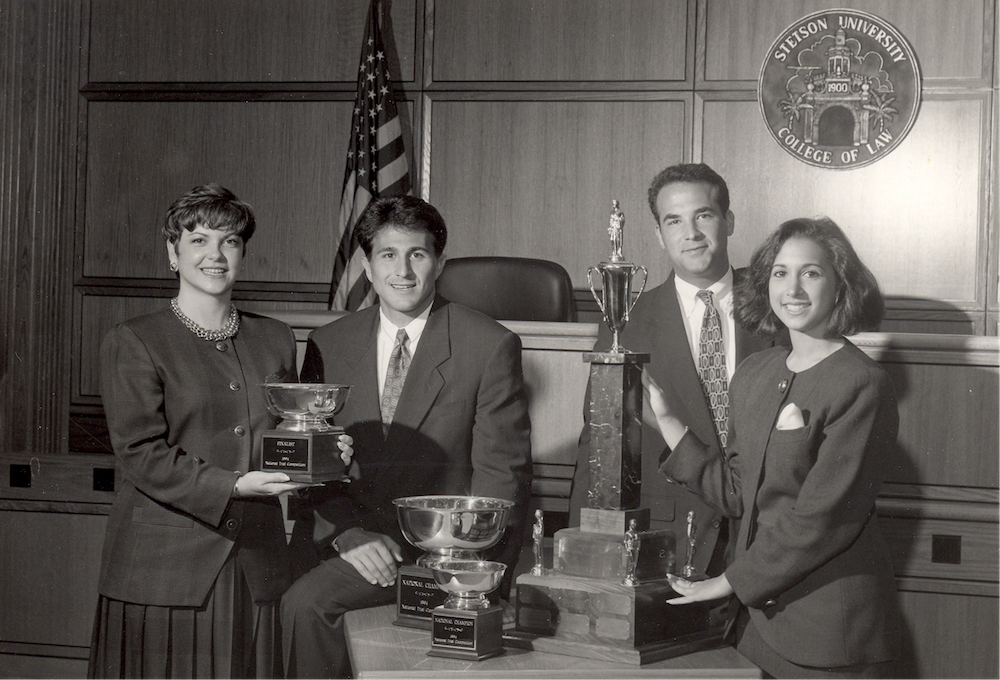 1994 Trial Advocacy Champions pose with award
