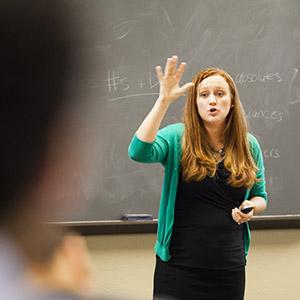 Academic Success staff member teaches in classroom