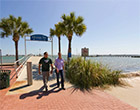 Two students walk by pier in Gulfport