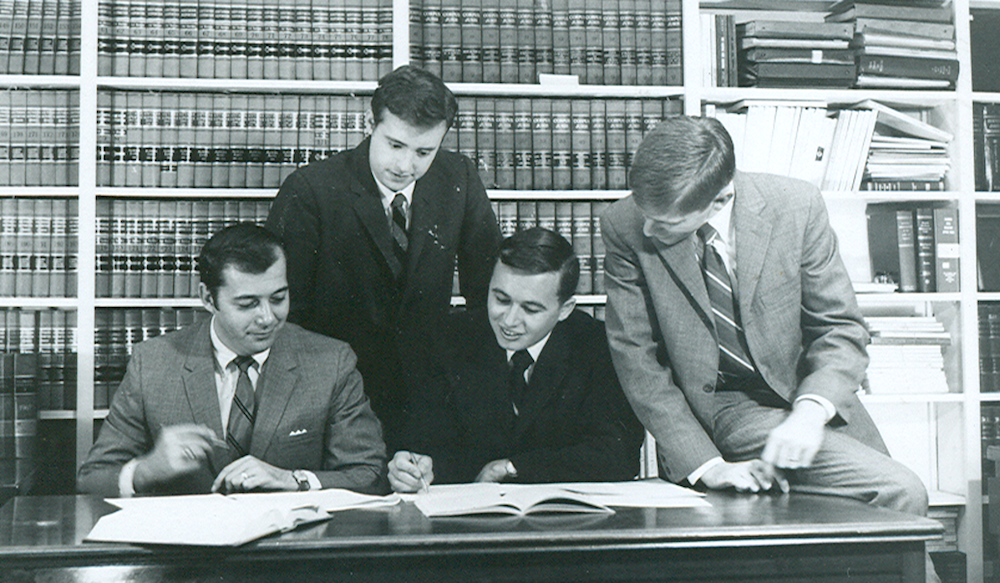 Stetson Law Review students gathered at a desk