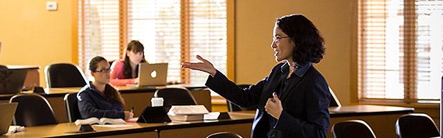 Professor teaches students in classroom