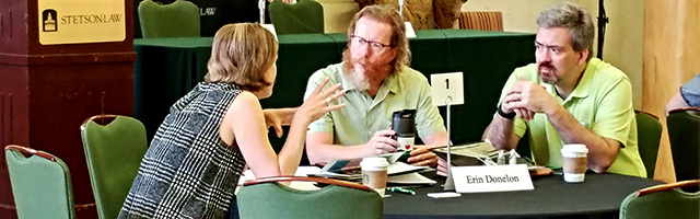 conference participants talk with each other at table