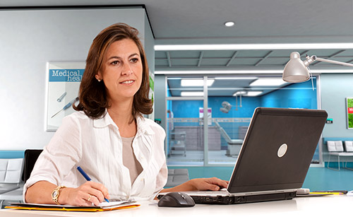 woman on laptop computer in hospital office