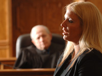 Professor Rose speaks from courtroom bench.