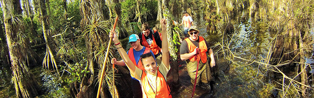 Stetson students and faculty walking in swamp