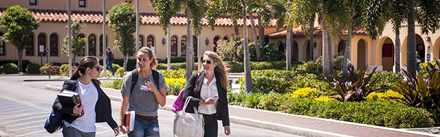 three students walk in Sebring Commons area on Gulfport campus