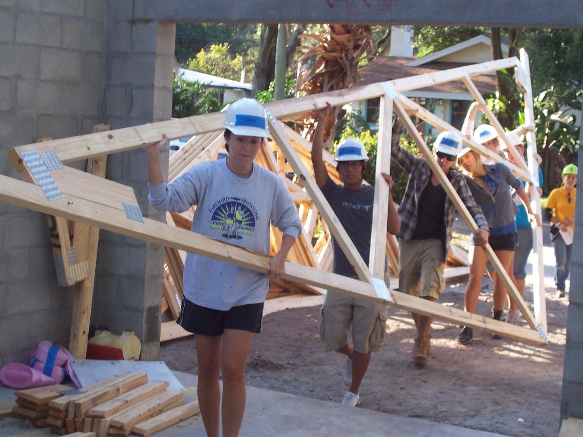 volunteers carry frame