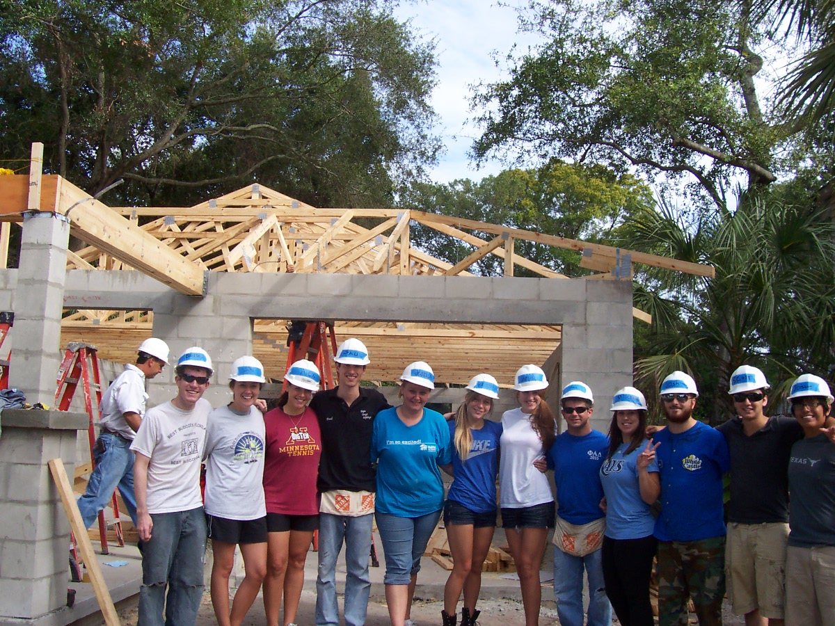 Group of volunteers outside Habitat for Humanity project