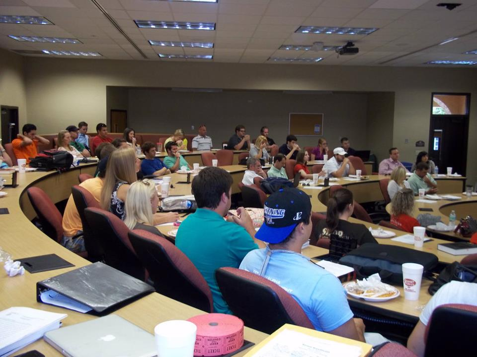 Students sitting behind rows of desks at Fall 2011 Meeting