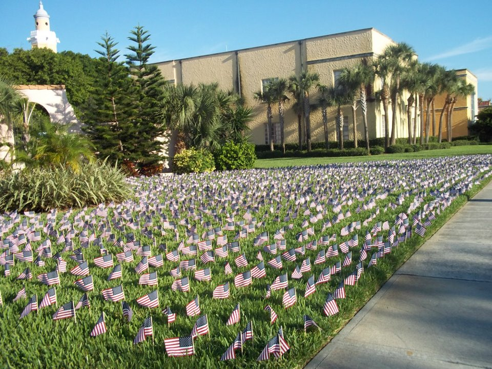 Several American flags are planted outside as a September 11 tribute