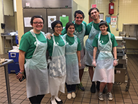 Group shot with aprons