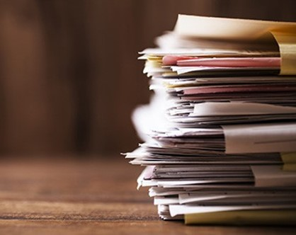 Files piled on a table