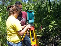 Geographic information systems (GIS) students map the growth of the trees to produce a survey map of the restoration.