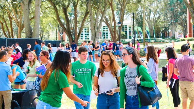 Gathering of Stetson students at exposition tables