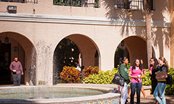 Students walking by the fountain in the Horseshoe on the Gulfport campus
