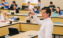 A professor teaching law students in a classroom