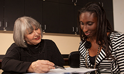 A Stetson Law career advisor working with a student