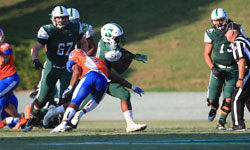 A Stetson University football running back avoid a tackle while running the ball.